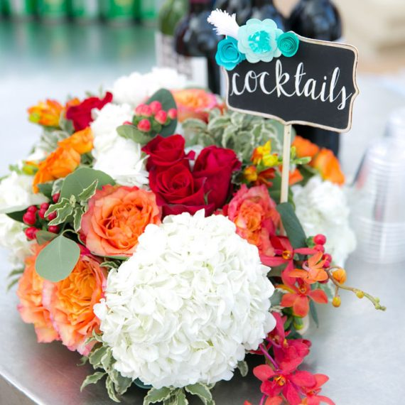 Cocktail table wedding centerpiece with sign